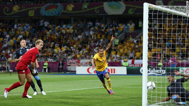 Martin Olsson of Sweden celebrates after Glen Johnson of England fails to stop Olof Mellberg of Sweden's goal during the group D match between Sweden and England on Friday, June 15, in Kiev, Ukraine.