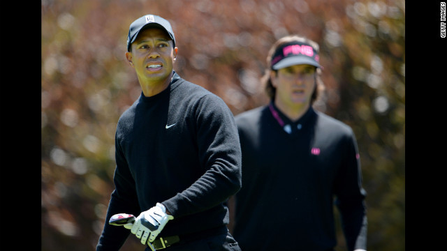 Tiger Woods, left, and Bubba Watson of the United States wait on the first tee during the second round of the 112th U.S. Open on Friday.