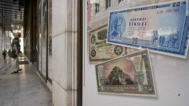 Replica drachma notes are displayed outside a bank on June 14, 2012 in Athens, Greece. The country goes to the polls on June 17, its second election in six weeks. It was called after the May 6 elections failed to deliver a government for the country, which has been struggling with a debt crisis for two years. 