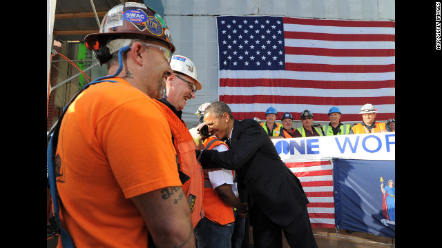 "Obama visits with workers. ""We couldn't be prouder of you guys,"" Obama told them. ""This is what the American spirit is all about.""<br/><br/>"