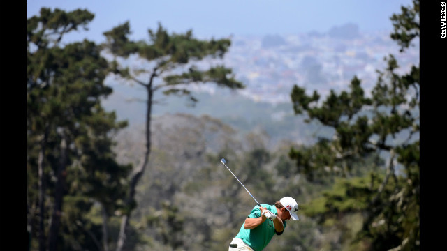Graeme McDowell of Northern Ireland hits a shot on the first hole.