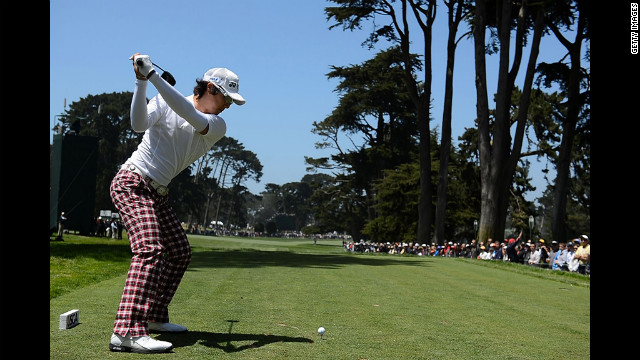 Ryo Ishikawa of Japan hits his tee shot on the tenth hole.