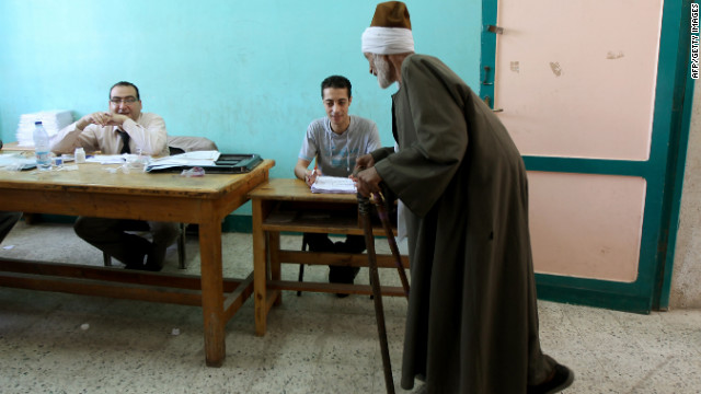 An elderly Egyptian man registers Saturday before voting in the city of Zagazig in an election that pits Ahmed Shafiq, the last premier of ousted President Hosni Mubarak, against Muslim Brotherhood candidate Mohammed Mursi.