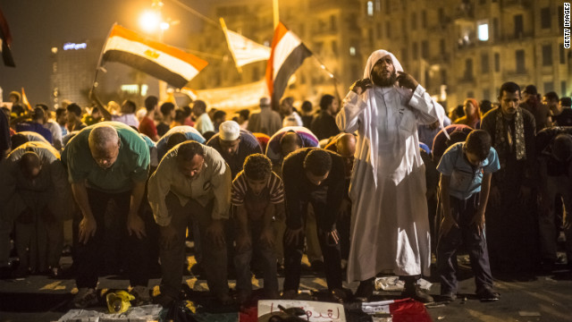 Egyptians pray in Tahrir Square on Thursday during a protest against presidential candidate Ahmed Shafik.