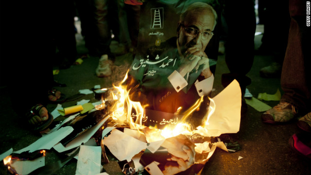 Egyptians burn the likeness of presidential candidate and former Prime Minister Ahmed Shafiq in Cairo on Friday, the eve of the nation's presidential election.
