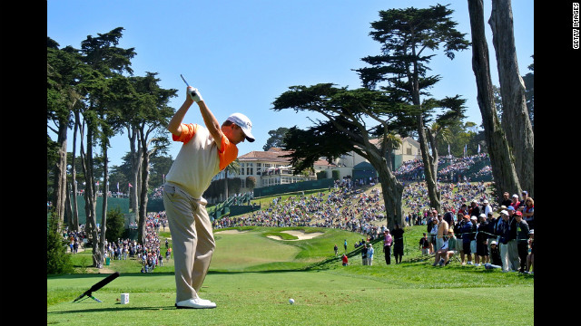 David Toms of the United States hits his tee shot on the eighth hole.
