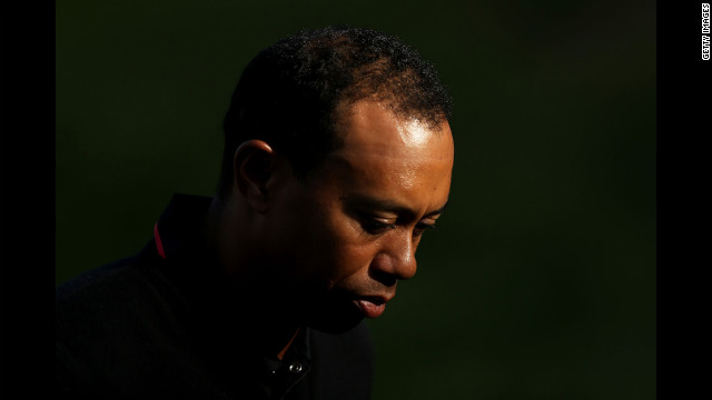 Tiger Woods walks off the 18th green.
