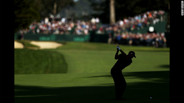 Tiger Woods hits a shot on the 16th hole.