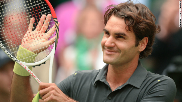 Swiss tennis star Roger Federer smiles after winning his semifinal against Mikhail Youzhny in Halle.