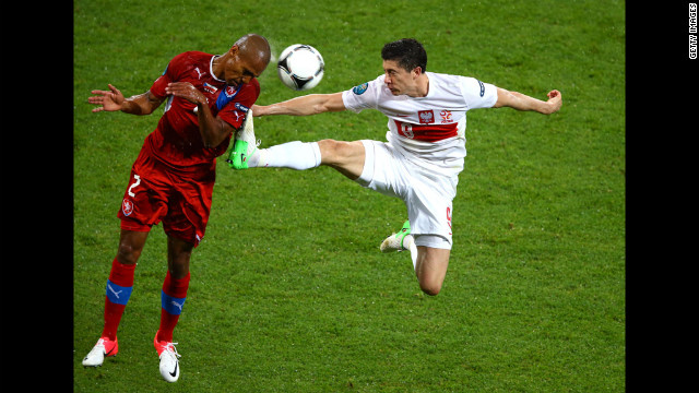 Robert Lewandowski of Poland tackles Theodor Gebre Selassie of Czech Republic during the group match between Czech Republic and Poland.