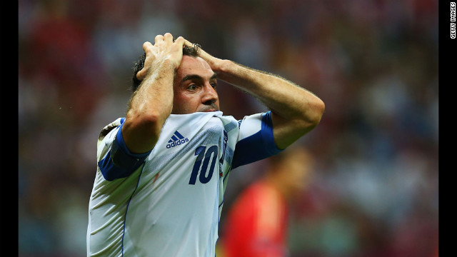 Giorgos Karagounis of Greece reacts after he receives a yellow card for diving from referee Jonas Eriksson during the match between Greece and Russia.
