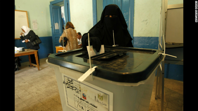 An full veiled Egyptian woman casts her vote at a polling station in Cairo on June 16.