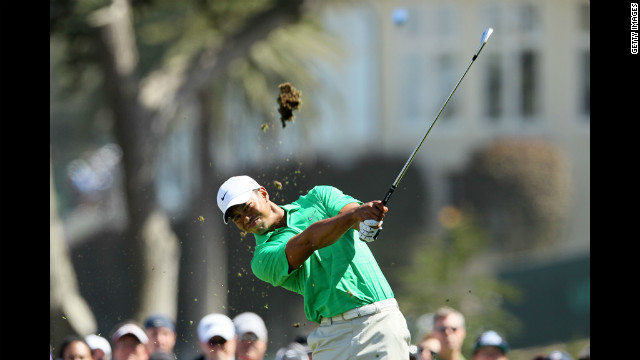 Tiger Woods watches his tee shot on the fourth hole during the third round.