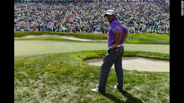 Graeme McDowell of Northern Ireland waits on the eighth green during the third round.