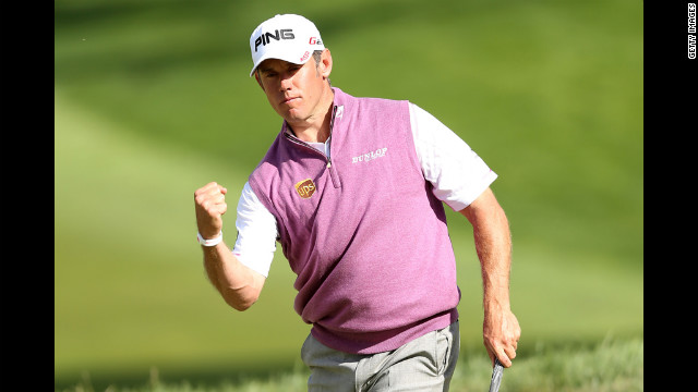 Lee Westwood of England celebrates his birdie putt on the 18th hole Saturday.