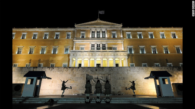 A night before the election, Greek Presidental Evzoni guards perform a change of the guard in in front of the Greek parliament in central Athens on June 16.