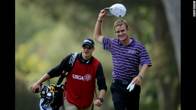 John Peterson of the United States celebrates a hole-in-one on the 13th hole with his caddie, Gentry Mangun.