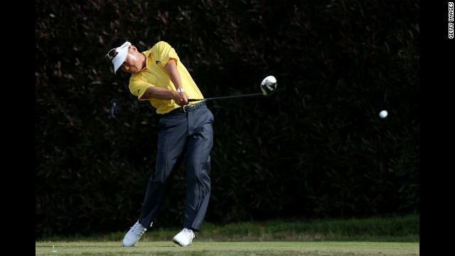 Charlie Wi of South Korea hits his tee shot on the 17th hole during the third round of the U.S. Open on Saturday.