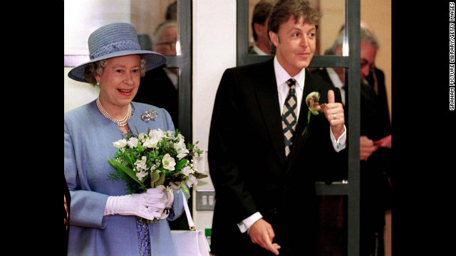 McCartney poses wtih Queen Elizabeth II at the Liverpool Institute for Performing Arts in 1996.