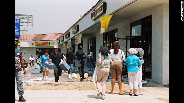 Looters rampage a shopping center in Los Angeles on April 30.
