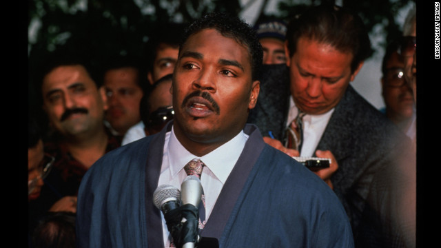 "Rodney King pleads to rioters to end the violence during a press conference in front of his lawyer's office on May 1 saying ""People, I just want to say, can we all get along? Can we get along? Can we stop making it horrible for the older people and the kids?"""