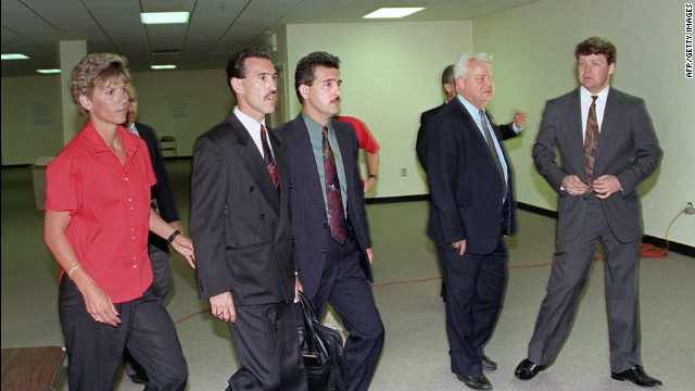 Officers Theodore J. Briseno, second from left, and Laurence M. Powell, right, are escorted out of the courthouse after they were acquitted of all charges except for one against Lawrence Powell on April 29, 1992. Hours after the officers acquittal rioting and looting broke out in South Central Los Angeles.