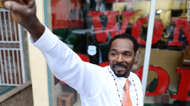 Rodney King gestures to supporters at an event in Los Angeles on April 30. King, whose videotaped beating by Los Angeles police in 1991 sparked the LA riots, was found dead Sunday, June 17. He was 47.