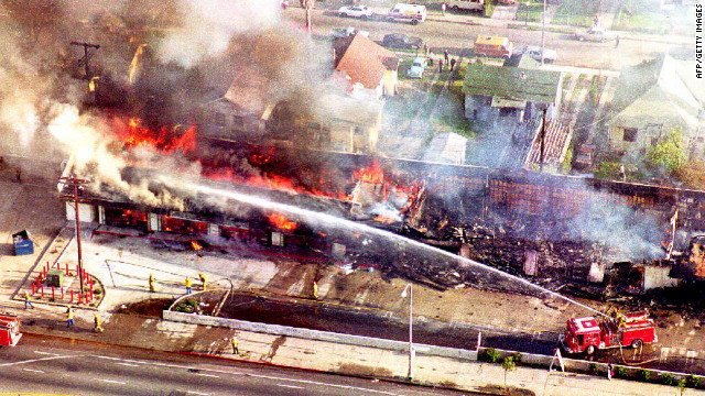A fire department crew attends to a burning building in south Los Angeles on April 30, 1992, a day after rioting broke out caused by the acquittal of four white police officers charged with assault and the use of excessive force on Rodney King.