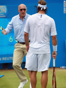 Line judge McDougall remonstrates with Nalbandian after the Argentina star's ill-judged kick left him with a gashed leg.