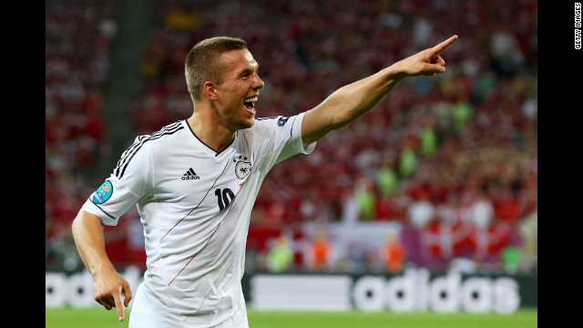 Lukas Podolski of Germany celebrates scoring the first goal against Denmark.