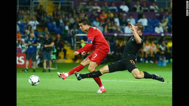 Portugal's Cristiano Ronaldo kicks the ball past a Dutch defender during Sunday's match.