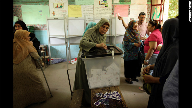 Women line-up to cast their vote at a polling station in Cairo on Sunday.