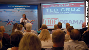 FreedomWorks\' Amanda Shell shows activists examples of materials her organization designs, prints and distributes to local tea party groups.
