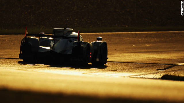 The Audi R18 Etron Quattro of Allan McNish, Rinaldo Cappello and Tom Kristensen in action as the race moved into the night.