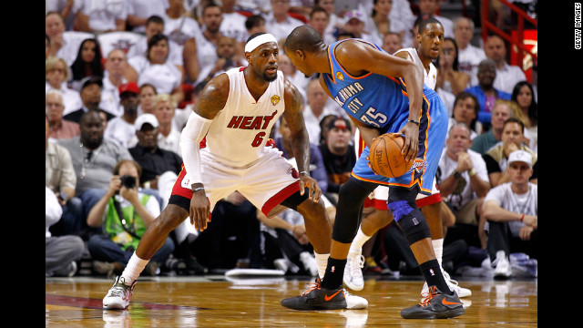 LeBron James defends against Kevin Durant during the first quarter.