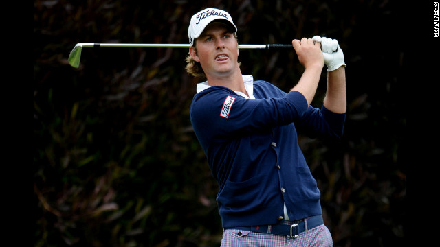 Webb Simpson hits his tee shot on the 13th hole of the 112th U.S. Open.
