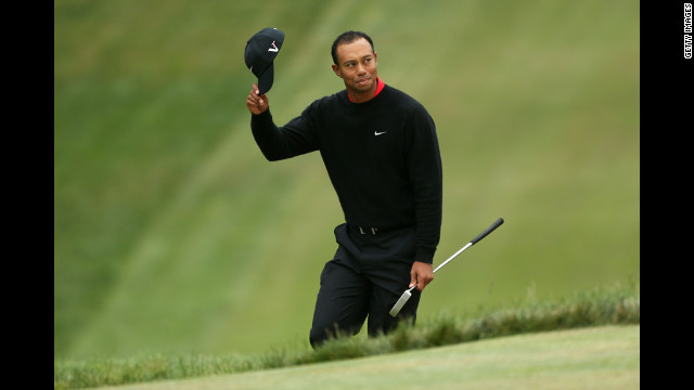 Tiger Woods of the United States waves to the crowd on the 18th green.