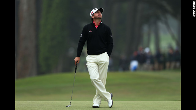 Graeme McDowell of Northern Ireland waits on the seventh green.