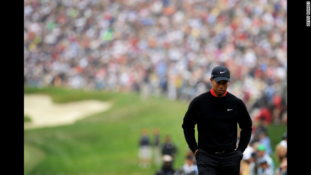 Tiger Woods walks to the eighth tee Sunday.