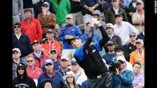 Jim Furyk hits his tee shot on the sixth hole.