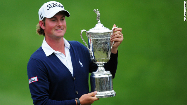 Webb Simpson holds his championship trophy after winning the 112th U.S. Open but will not be at the British Open.