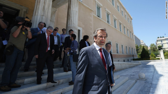 Antonis Samaras leader of the New Democracy party, leaves the Parliament building following a meeting with the leader of Syriza, Alexis Tsipras, to attempt to form a coalition government on June 18, 2012 in Athens, Greece.