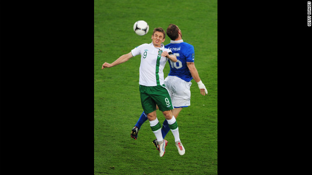 Kevin Doyle of Ireland and Daniele De Rossi of Italy jump for the ball on Monday.