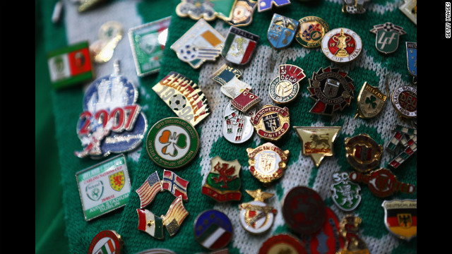 Badges adorn an Ireland fan's scarf ahead of the group C match between Italy and Ireland.
