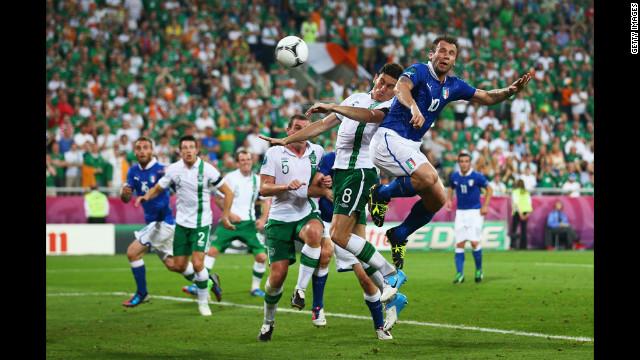 Italy's Antonio Cassano heads in the opening goal against Ireland.