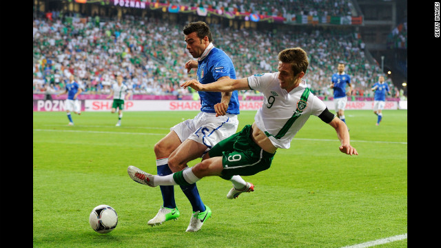 Italy's Andrea Barzagli tackles Ireland's Kevin Doyle on Monday.