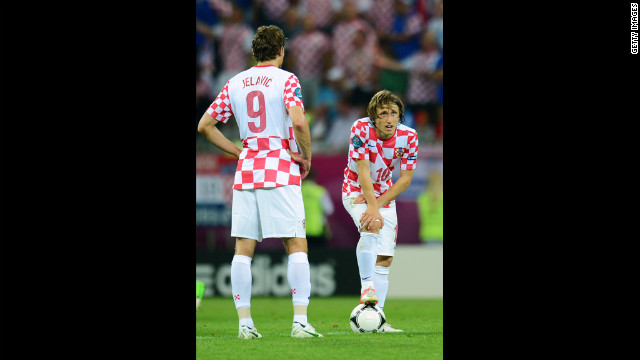 Croatia's Luka Modric looks on after Spain's Jesus Navas scores a goal.