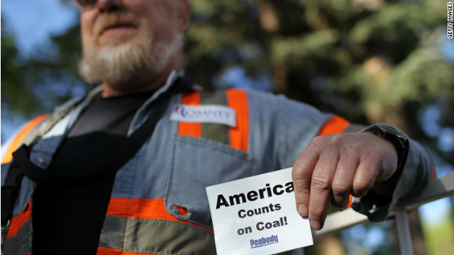  A coal miner holds a sign during a campaign rally for Republican presidential candidate Gov. Mitt Romney in Craig, Colorado. 