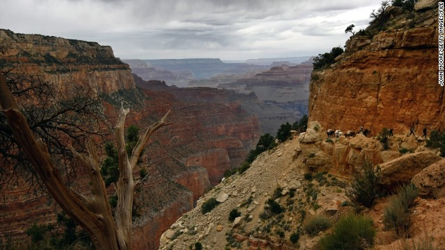 Grand Canyon National Park in Arizona measures up to 18 miles wide and a mile deep and displays geologic history dating back 2 billion years. Enough said.