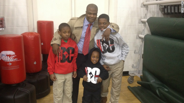Tony Lewis Jr. poses with Sons of Life members Deerick Banks, left, Kanye Turner, center and Antionio Johnson, Jr., right.